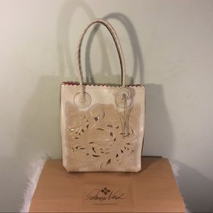 A beautiful off white floral leather tote.